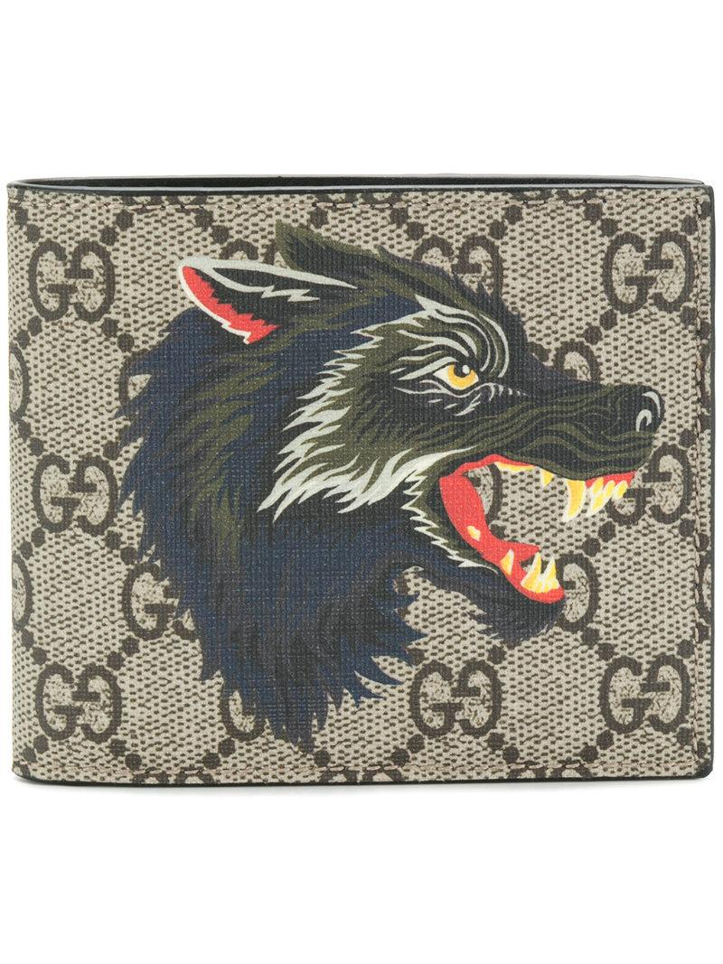 aa9b762fdec Gucci Wolf Printed Gg Supreme Classic Wallet In Beige Multi. Farfetch. 380Login  to see price