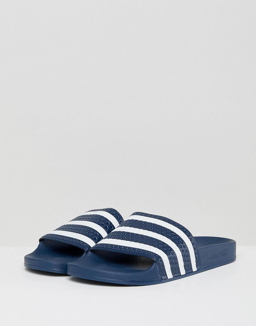 4c1b24167419 Adidas Originals Adidas Men s Adilette Slide Sandals From Finish Line In  New Navy White