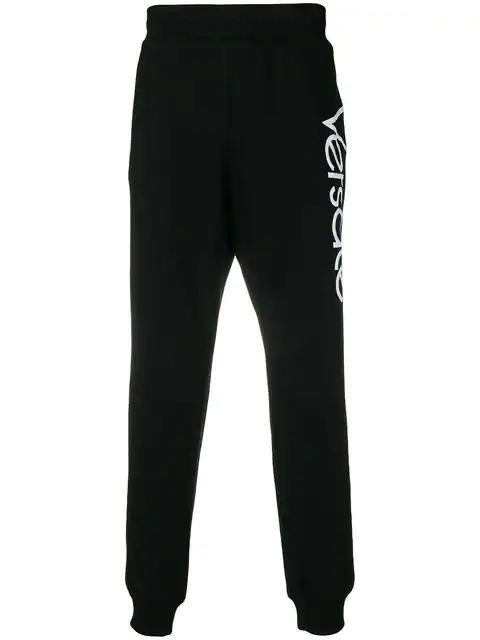 Versace Printed Logo Cotton Jersey Sweatpants In A008 Black