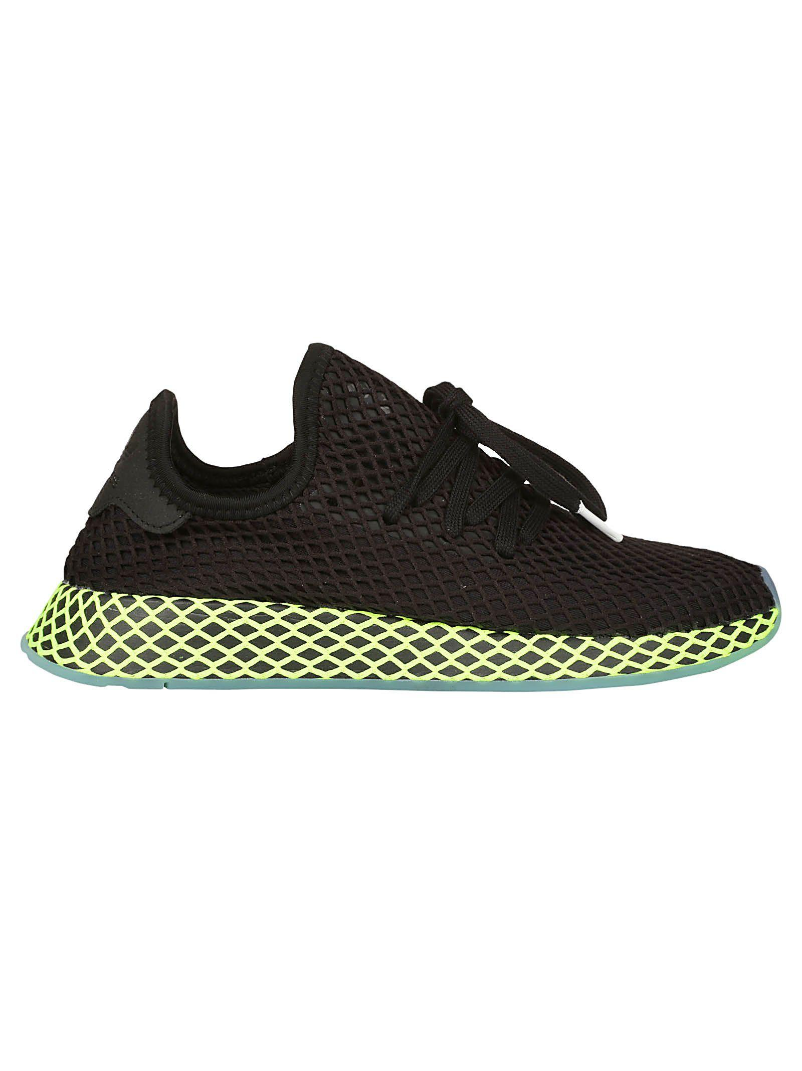 official photos c74c5 f0bcd Adidas Originals Adidas Black And Green Deerupt Runner Sneakers