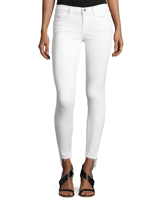 21b82d20 Frame Le Skinny De Jeanne Mid-Rise Raw Stagger-Hem Jeans In White ...