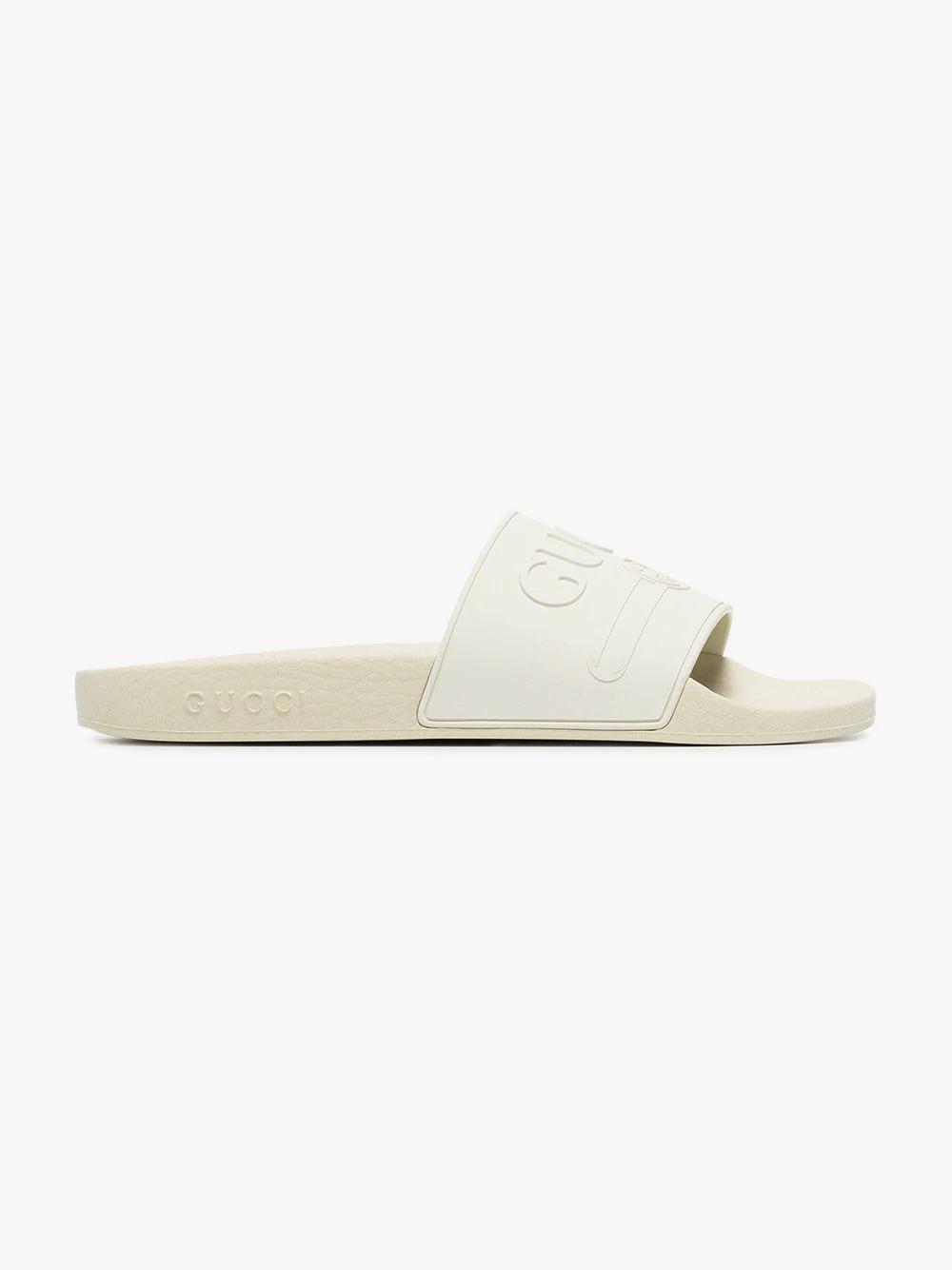 8b0c84cebafc76 Gucci Rubber Logo Slide Sandals In White