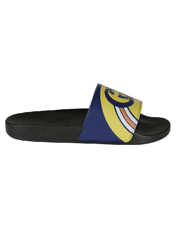 1abebfa1b Gucci Men's Interlocking G Rainbow Rubber Slide Sandals In Blue ...