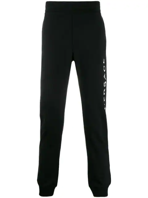 Versace Printed Logo Cotton Jersey Sweatpants In Black