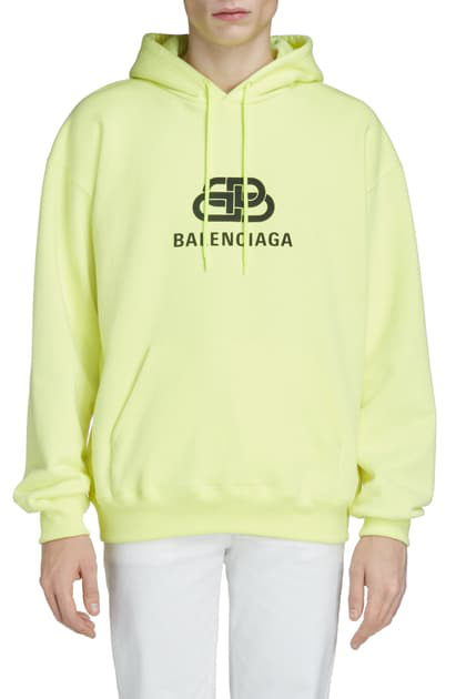 Balenciaga Oversized Logo-print Washed Loopback Cotton-jersey Hoodie In 7050 Yellow