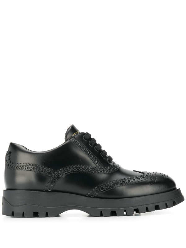 Prada Oversized Brogue Leather Trainers In Black