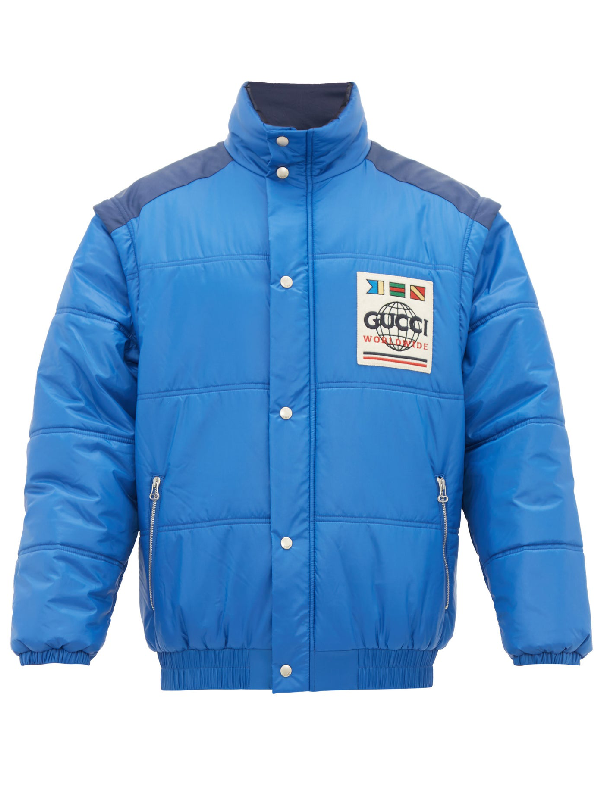 Gucci Worldwide Logo Detachable-sleeve Puffer Jacket In Blue