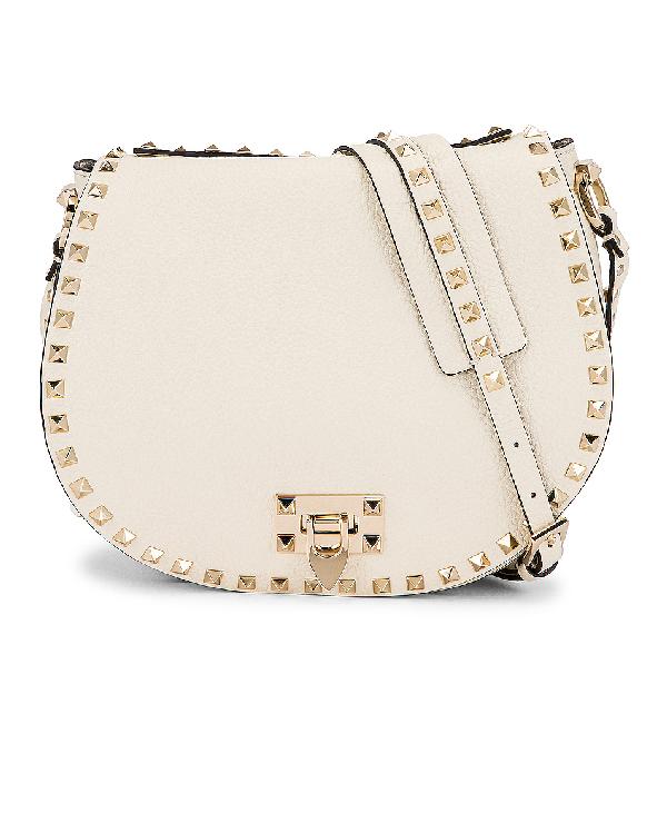 Valentino Garavani Small Rockstud Saddle Bag In Light Ivory