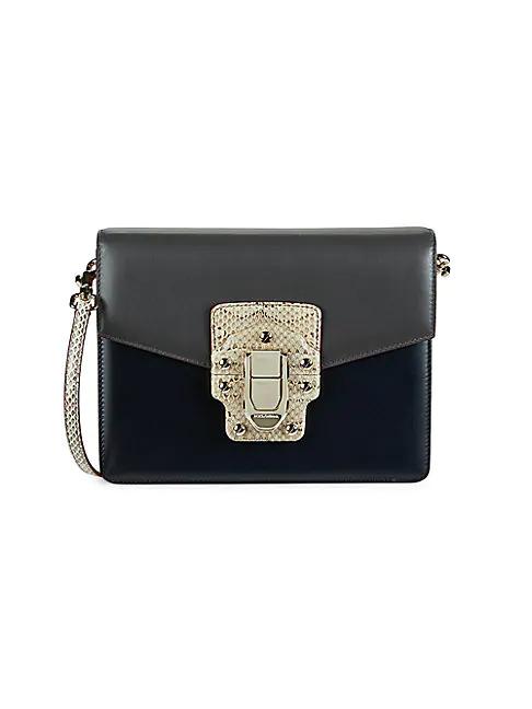Dolce & Gabbana Serpentine-print Studs & Buckle Shoulder Bag In Black