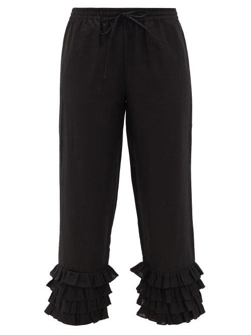 Muzungu Sisters Talitha Ruffled-hem Linen Trousers In Black