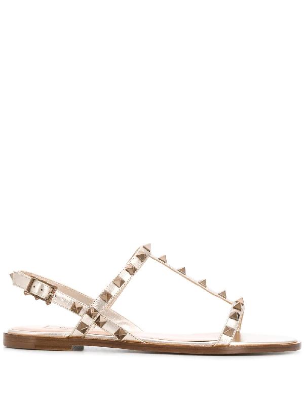 Valentino Garavani Rockstud Flat Sandals In Gold