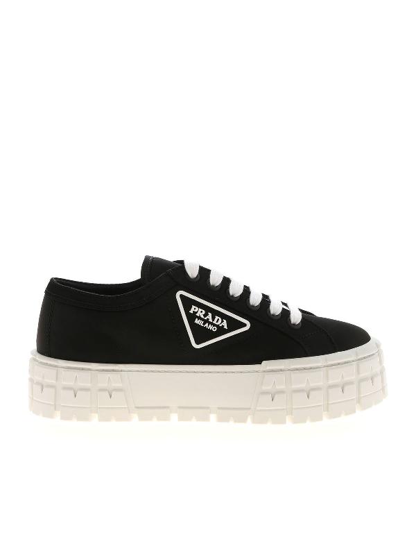 Prada Triangular Logo Plaque Sneakers In Black