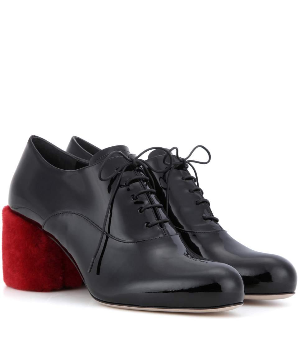 4512a86ba49 Patent leather fur-trimmed pumps