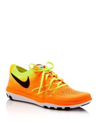 Nike Women's Free Focus Flyknit Training Sneakers From Finish Line In Orange/black