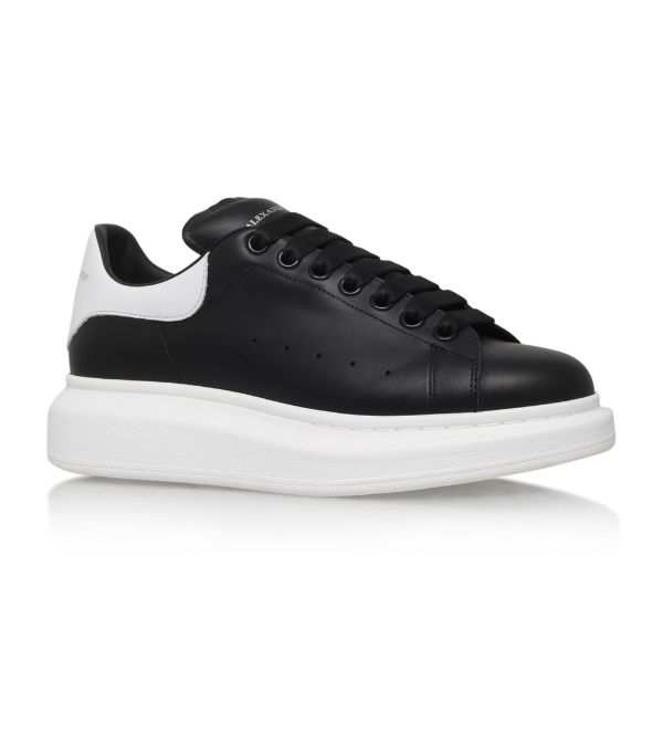 Alexander Mcqueen Exaggerated-sole Rubber-trimmed Leather Sneakers In Black