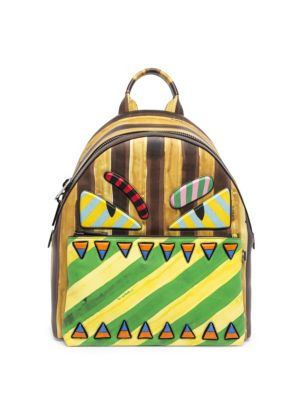 607670765d high attitude statement backpack is sure to set you apart from the masses.  This vibrant piece is crafted from leather and decorated with a Monster- themed ...