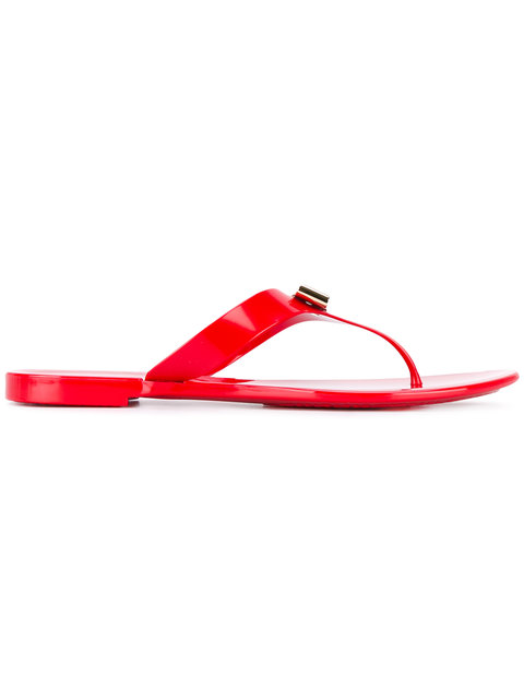 ef89cdcaa34 ... refinement to a streamlined thong sandal grounded with a logo-patterned  footbed. Style Name  Salvatore Ferragamo Farelia Jelly Flat Bow Sandal ( Women).