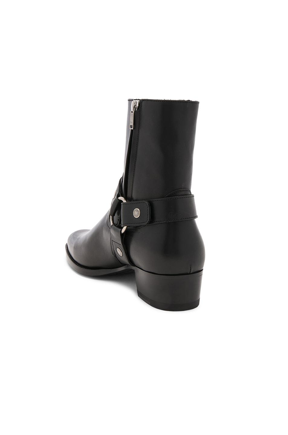 Saint Laurent Wyatt Harness Boots In Stone-Washed Leather In Black