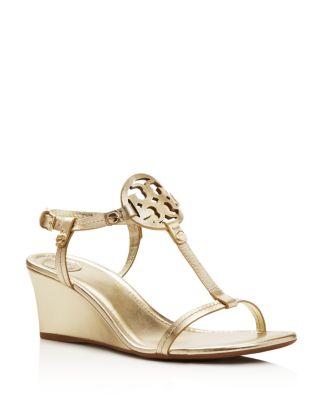 0f4d913682d0fb Tory Burch Miller T Strap Logo Wedge Sandals In Spark Gold