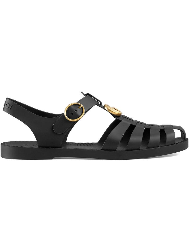 c96ca2bf4b7 Gucci Tiger Head Rubber Buckle Sandals In Black