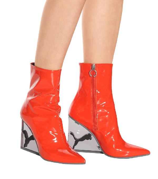 new photos 4cc3c c2ae7 Fenty Puma X Rihanna Women's Patent Leather Cat Wedge Booties in Orange