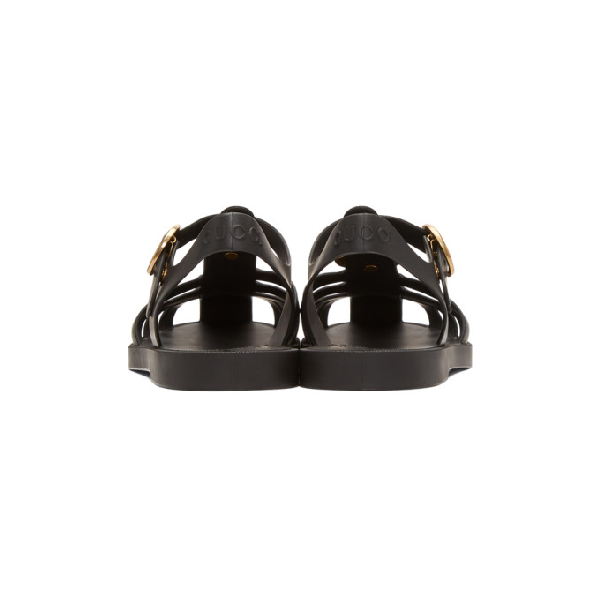 c20b9c93013b Gucci Tiger Head Rubber Buckle Sandals In Black
