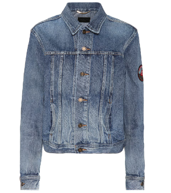 2be94eb68a2 Saint Laurent Original Ysl Military Patch Jean Jacket In Washed Blue Shadow  Denim. Mytheresa. 894Login to see price