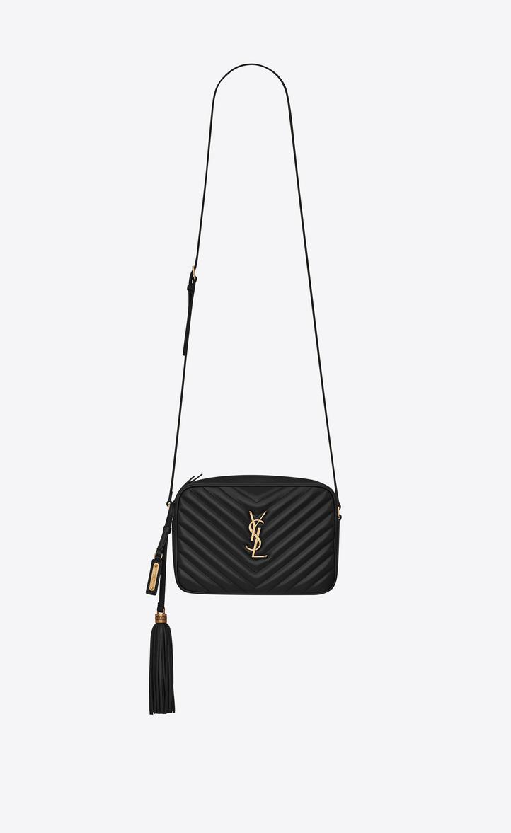 8d42b52fcd72 Saint Laurent s Lou medium camera bag is constructed in Italy of dark green  matelassé calfskin. Accented with the French house s signature YSL logo
