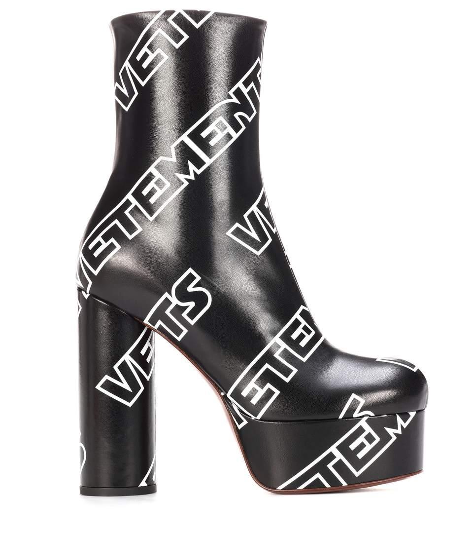 4bd888798cb Vetements 130Mm Logo Print Leather Platform Boots In Black