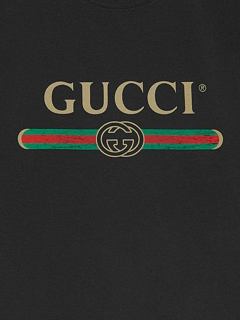 GUCCI Washed T-shirt with Gucci logo,440103X3F0512416318
