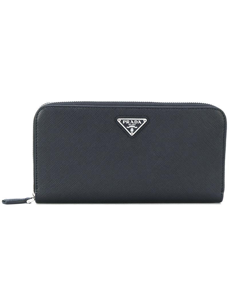 6459ff3b6dc2 Prada Saffiano Zip Wallet - Farfetch In Black | ModeSens