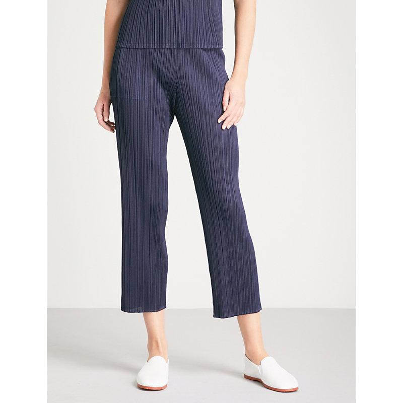 83a51d6a90184 Pleats Please Issey Miyake Basics Cropped Pleated Trousers In Navy ...