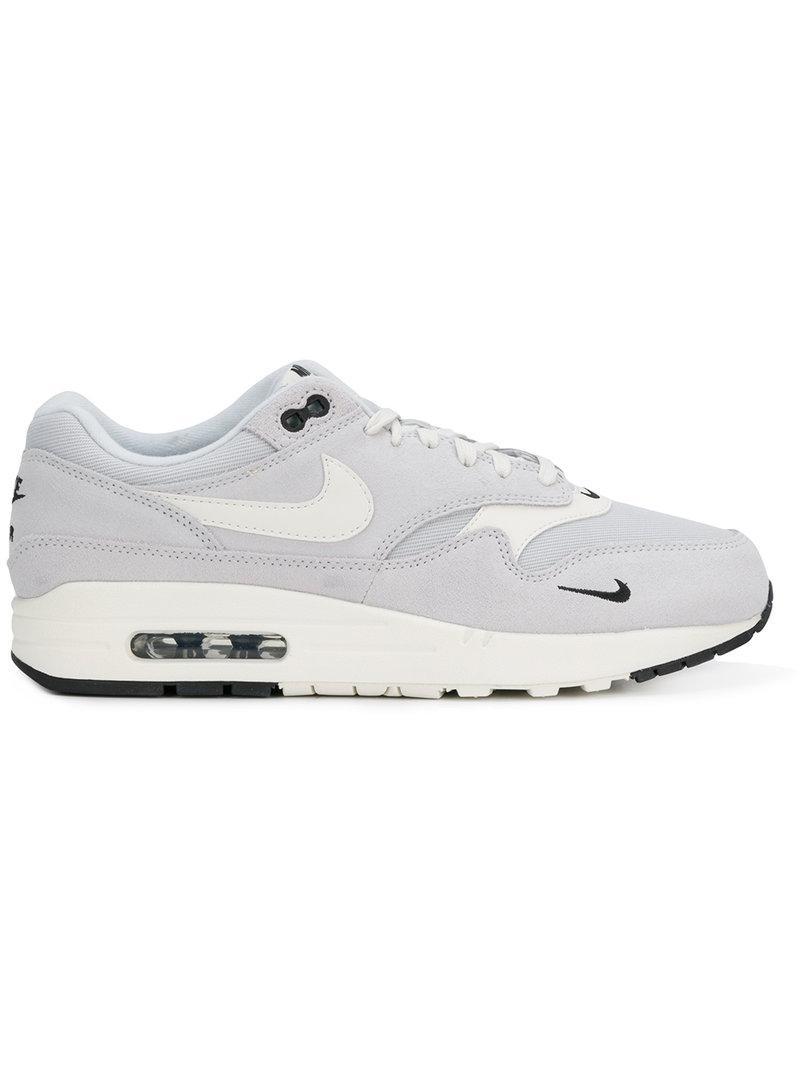 buy popular 45c75 5d701 Nike Air Max 1 Premium Grey Suede And Fabric Sneaker In Blue
