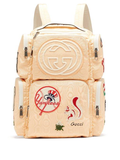 414b9c98e52 Gucci Patch-Embellished Leather-Trimmed Canvas Backpack In Light Yellow
