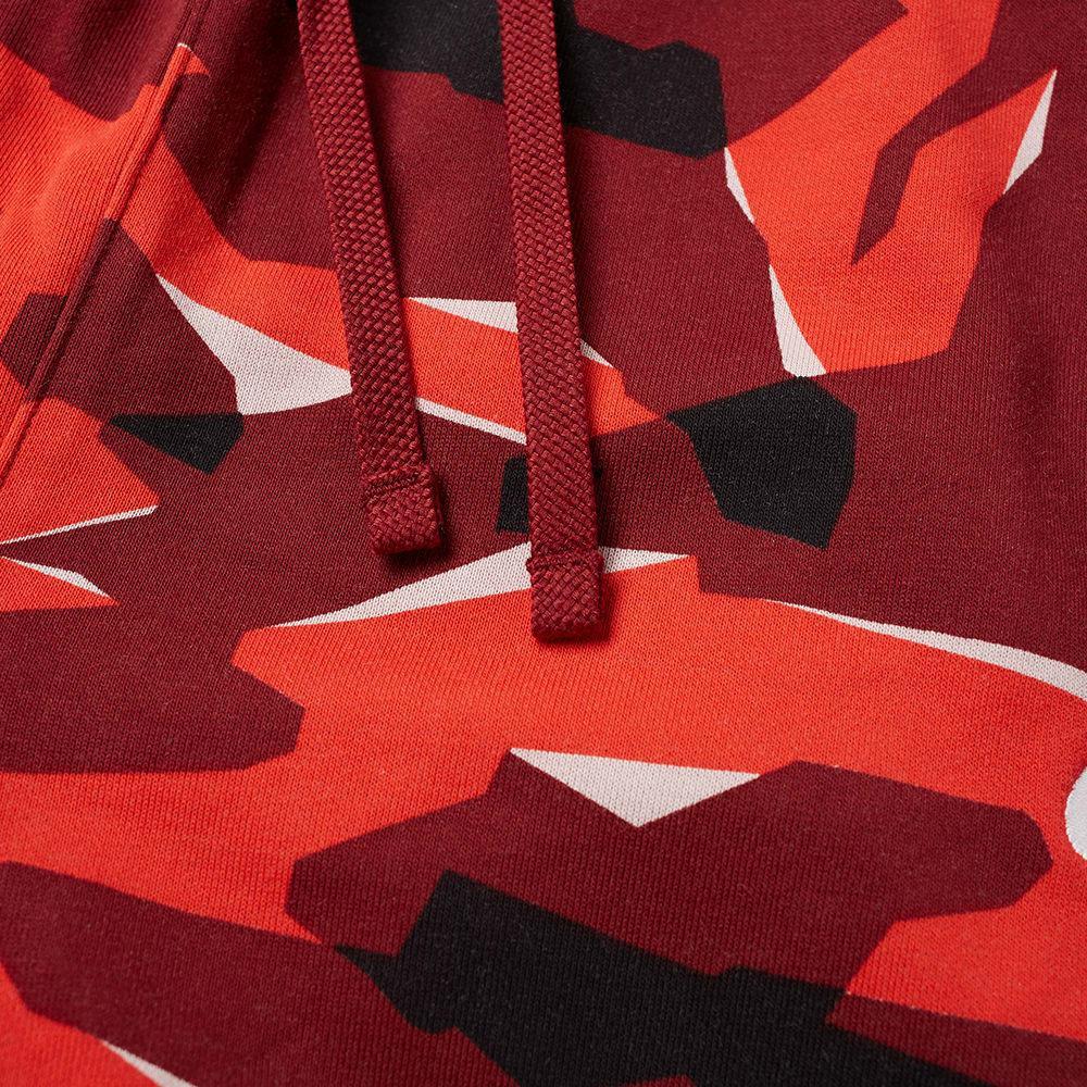 1e34569ead1a Nike Club Camo Sweat Pant in Red