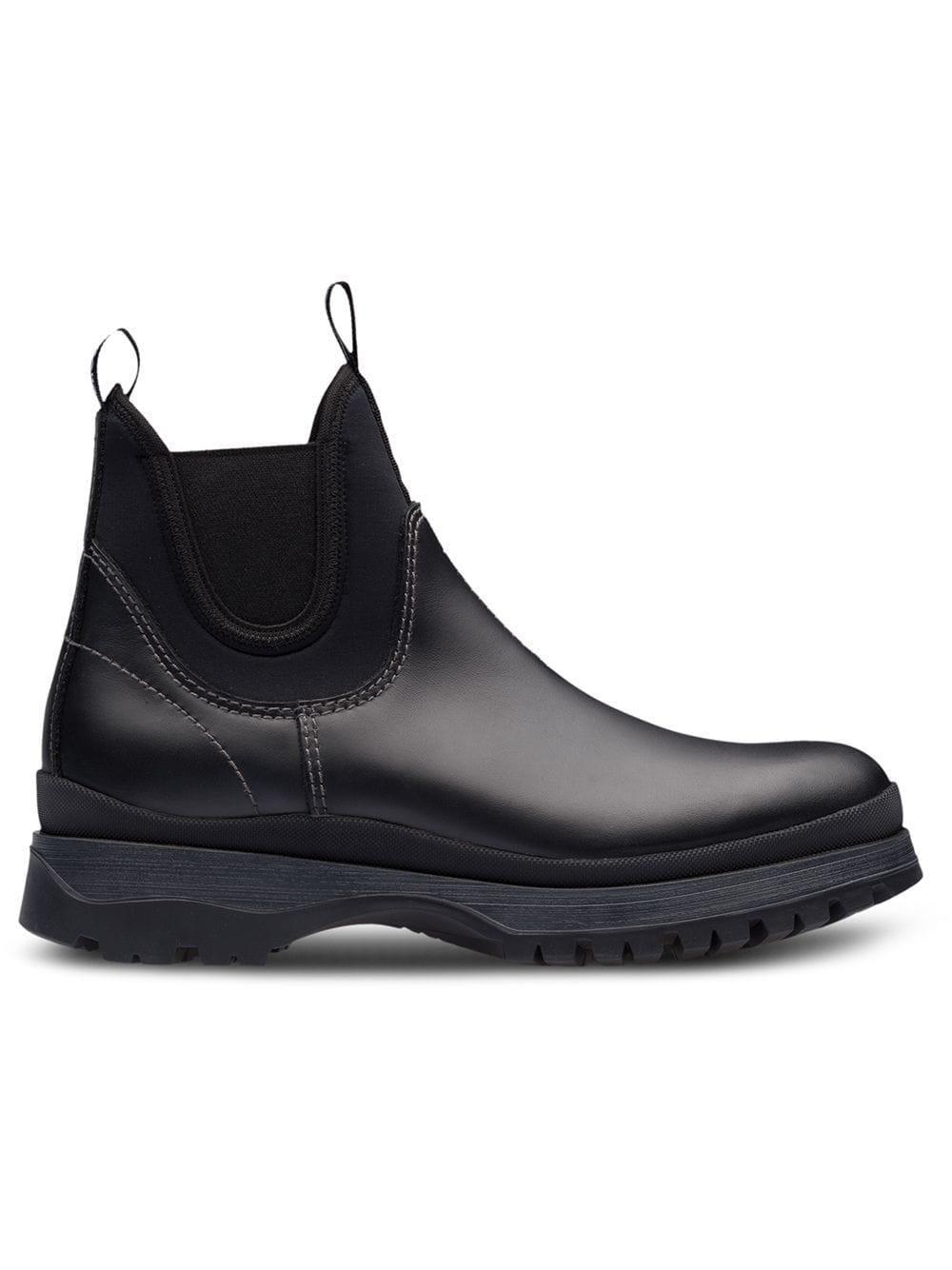 a1aa78282ae6 Prada Paneled Neoprene And Leather Chelsea Boots In Black | ModeSens