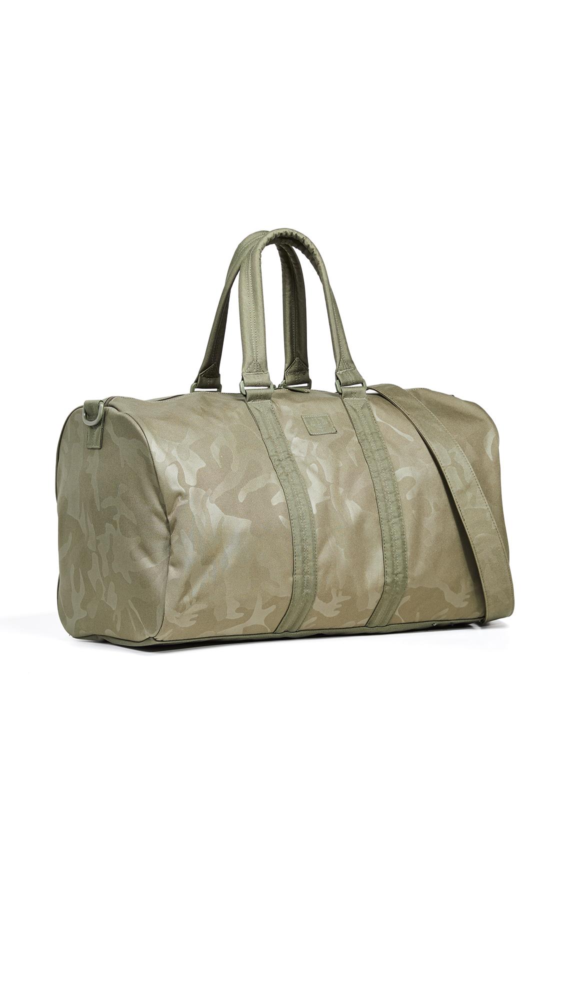 899bd23d84b54 Herschel Supply Co. Novel Duffel Bag In Olive Night Tonal Camo ...