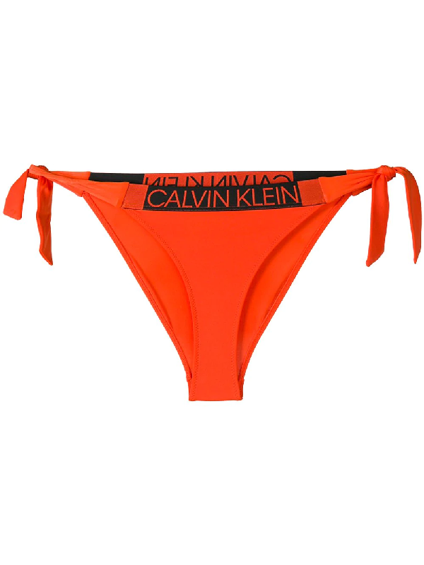 eb43aef785107 Calvin Klein Logo Band Bikini Bottoms - Orange | ModeSens