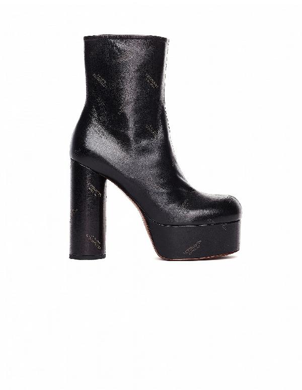 3f75b4209b433 Vetements 130Mm Logo Print Leather Platform Boots In Black | ModeSens