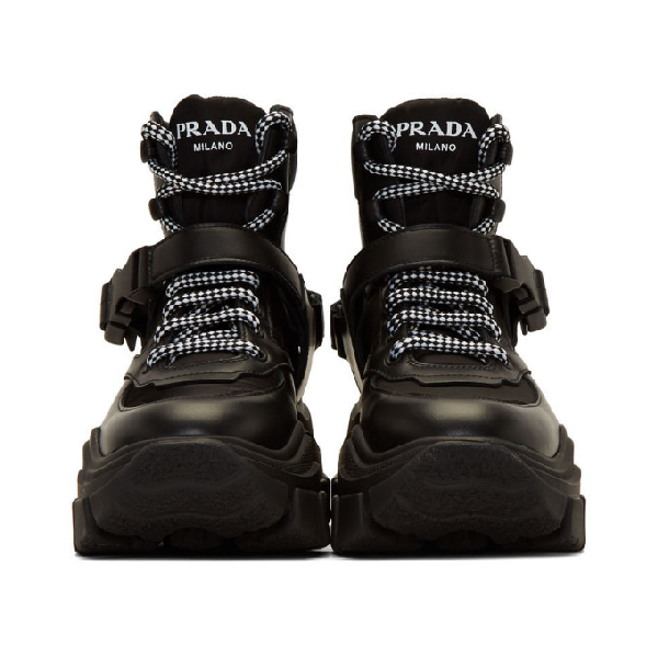 b486ee3de81 Logo-Embossed Rubber And Neoprene-Trimmed Leather Ankle Boots in Black