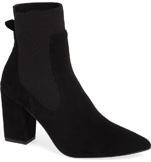 38a78a6cd82 An inset sock replaces the goring of a ready-for-entrances Chelsea bootie  shaped with a pointy toe and a rectangular demiblock heel. Style Name  Steve  ...
