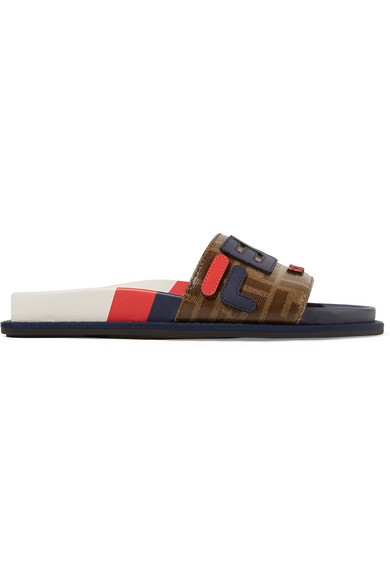 0a78e1cb9a7 Available in Brown Dark Brown Multi. Made in Italy. Fendi Women s Fendi  Mania Rubber Slide Sandals - Blue Size 10 A great designer gift. Shop Fendi  at ...