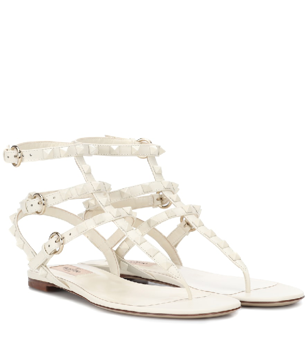702ec69a457 Valentino Rockstud Flat Strappy Leather Sandals (Tonal Hardware) In White