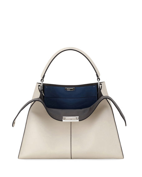 6b46adc34f Fendi satchel bag in soft calf leather with lambskin interior. Padded tote  handle with rings. Framed top with double-sided turn-lock closures. Approx.