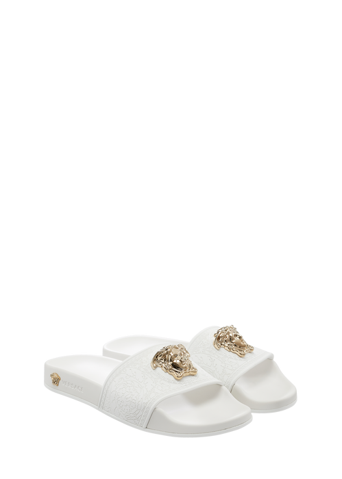 f62e66233 These white Medusa pool slides from Versace feature an embossed finish