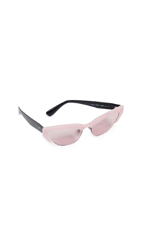 db4bb44f6e3 Miu Miu Narrow Cat Eye Sunglasses In Glitter Pink
