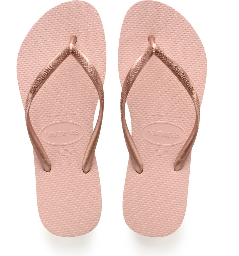 b670aa2ce Add a dose of glitz and glamour to your footwear collection with these  sparkling Havaianas flip-flops. A slim metallic top strap features a  dazzling ...