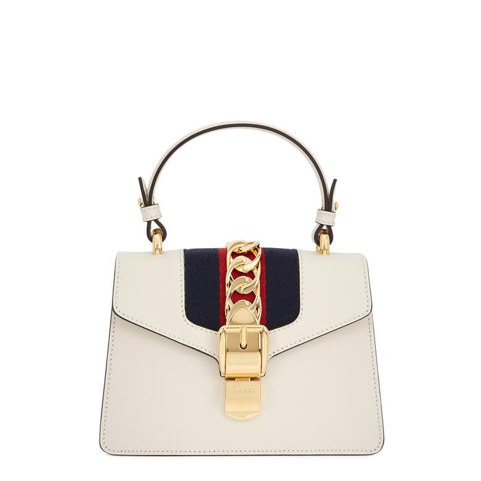 6b2d11618 Gucci Sylvie Mini Cream Cross-Body Bag In White. Harvey Nichols