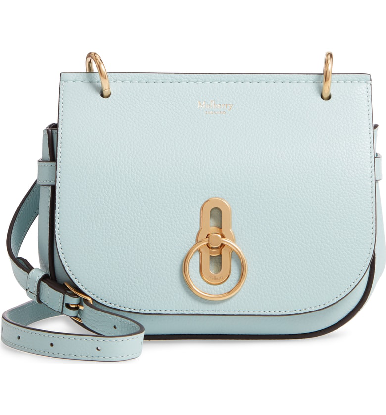 fc5b766edd Classic equestrian styling informs both the saddle silhouette and ring  hardware of a leather bag designed to be worn crossbody or over the shoulder .