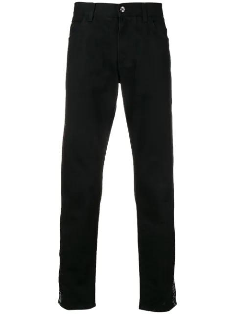 Dolce & Gabbana Embossed Logo Stretch Denim Jeans In Black